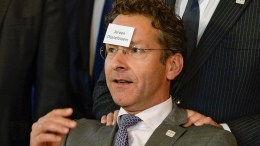 President of the Eurogroup, Dutch Finance Minister Jeroen Dijsselbloem jokes with a sticker reading his name during a family photo at the Informal Meeting of EU Finance Ministers (ECOFIN) in Bratislava, Slovakia. EPA, FILIP SINGER