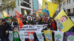 FILE PHOTO. Kurdish demonstrators hold signs and march during a protest against the policies of Turkish President Recep Tayyip Erdogan. EPA, FRANZISKA KRAUFMANN