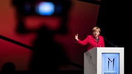 German Chancellor Angela Merkel speaks during the opening of the Munich Media Days at the International Congress Center in Munich, Germany. EPA, Sven Hoppe