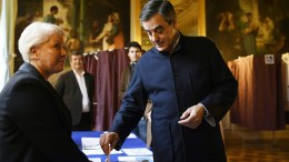 French member of Parliament and candidate for the right-wing primaries ahead of the 2017 presidential elections, Francois Fillon (R) casts his ballot in a polling station in Paris, France, 27 November 2016, during the second round of the primary. France's conservatives hold final run-off round of a primary battle on November 27 to determine who will be the right- wing nominee for next year's presidential election. EPA/ERIC FEFERBERG / POOL
