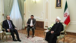 A handout picture made available by the Iranian presidential official website shows Iranian president Hassan Rouhani (R) talks with Turkish foreign minister Mevlut Cavusoglu (L) in Tehran, Iran, 26 November 2016. EPA/IRANIAN PRESIDENTIAL OFFICIAL WEBSITE / HANDOUT