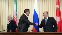 Russian Foreign Minister Sergei Lavrov (C) shakes hands with his Turkish counterpart Mevlut Cavusoglu (R) as Iran's Foreign Minister Mohammad Javad Zarif (L) looks on after a news conference in Moscow, Russia, 20 December 2016. Russia, Iran and Turkey agreed to guarantee Syria peace talks and backed expanding a ceasefire in the war-torn country, Russian foreign minister said after talks with counterparts. EPA, NATALIA KOLESNIKOVA / POOL