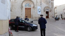 Carabinieri officers stand guard at the front entrance of Chiesa Madre (Mother Church) where a mass in memory of a Canadian 'Ndrangheta mafia boss Rocco Sollecito, was cancelled in Grumo Appula village, near Bari, Italy, 27 December 2016. The local priest Father Michele Delle Foglie had planned a public ceremony, but the local bishop and town mayor cancelled the plans amid accusations of the priest's incompatibility of interests with the parish and Sellecito's family business. Ndrangheta, the Calabrian-based mafia, has strong offshoots abroad and especially in Canada and Australia. EPA, ANNAMARIA LOCONSOLE