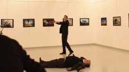 File Photo: Gunman (C) stands near slain Russia's ambassador to Turkey, Andrey Karlov's body (down) after he shot him during an art exhibition in Ankara, Turkey, 19 December 2016. Russia's ambassador to Turkey, Andrey Karlov, has been shot at an art exhibition in the Turkish capital of Ankara. EPA, STR TURKEY OUT