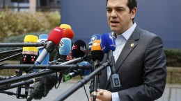Greece Prime Minister Alexis Tsipras speaks to media as he arrives for the European summit in Brussels, Belgium. EPA, JULIEN WARNAND