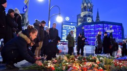 FILE PHOTO. People lay flowers and light candles near the scene of an attack in Breitscheidplatz square in Berlin, Germany. EPA/Britta Pedersen