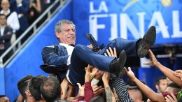 Portugal's coach Fernando Manuel Costa Santos is lifted in the air after his team won the UEFA EURO 2016 Final match against France at Stade de France in Saint-Denis, France, 10 July 2016.    (RESTRICTIONS APPLY: For editorial news reporting purposes only. Not used for commercial or marketing purposes without prior written approval of UEFA. Images must appear as still images and must not emulate match action video footage. Photographs published in online publications (whether via the Internet or otherwise) shall have an interval of at least 20 seconds between the posting.)  EPA/GEORGI LICOVSKI   EDITORIAL USE ONLY