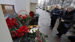 People visit a small memorial outside the home stage of the Alexandrov Ensemble (The Red Army Choir), in Moscow, Russia, 25 December 2016. According to media reports, a Tupolev-154 Russian airplane carrying at least 92 people, including 65 members of the musical group, disappeared from radar and crashed into the Black Sea after taking off from an airport in Sochi on 25 December. The plan was also carrying eight crew members, nine Russian journalists as well as Russian civil activist, Doctor Yelizaveta Glinka (Doctor Liza). No survivors have been found. EPA/MAXIM SHIPENKOV