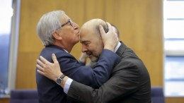 File Photo: European Commission President Jean-Claude Juncker (L) kisses the forehead of European Commissioner in charge of Economic and Financial Affairs Pierre Moscovici (R), welcome each other at the start of the weekly meeting of the European Commission in Brussels, Belgium, 10 January 2017. EPA, OLIVIER HOSLET
