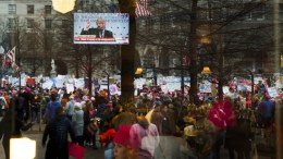People are seen reflected during the Women's March and rally to protest President Donald J. Trump, seen on a television screen speaking at the Central Intelligence Agency, the day after he was sworn in as the 45th President of the United States, in Washington, DC, USA, 21 January 2017. Protest rallies were held in over 30 countries around the world in solidarity with the Women's March on Washington in defense of press freedom, women's and human rights following the official inauguration of Donald J. Trump as the 45th President of the United States of America in Washington, DC, USA, on 20 January 2017. EPA, JUSTIN LANE