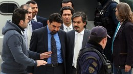 FILE PHOTO: Turkish military officers, accused by the Turkish Government of participating in the country's foiled coup attempt last July, are escorted by Greek Police officers out of the Supreme Court in Athens, Greece. EPA, ORESTIS PANAGIOTOU