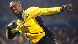 Gold medalist Usain Bolt of Jamaica strikes his trademark pose during the medal ceremony for the men's 100m of the Rio 2016 Olympic Games Athletics, Track and Field events at the Olympic Stadium in Rio de Janeiro, Brazil, 15 August 2016.  EPA/YOAN VALAT