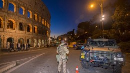 A soldier of Italian Army guards at the Colosseum area. EPA/CLAUDIO PERI
