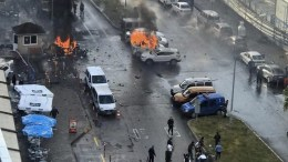 FILE PHOTO. Cars burn after explosion while police try to help injured people in Turkey. EPA/STR BEST QUALITY AVAILABLE