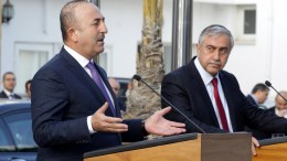 Turkish Foreign Minister Mevlut Cavusoglu (L) with the Turkish Cypriot leader Mustafa Akinci (R) give a press conference in Turkish occupied Nicosia, Cyprus, 21 February 2017. EPA, STR
