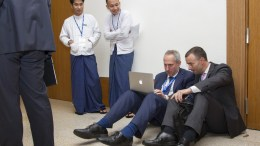 Stéphane Dujarric (second from right), Spokesperson for the Secretary-General, at work with a colleague during the Ninth East Asia Summit, held in Myanmar's capital, Nay Pyi Taw. UN Photo/Rick Bajornas