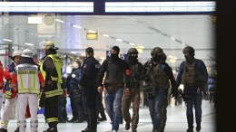 Paramedics and special police officers at the scene of crime in the central station of Duesseldorf, Germany, 09 March 2017. According to reports, several persons were injured in an axe-wielding attack inside the central train station. Two person were arrested by the police. EPA, STR