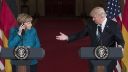 FILE PHOTO: US President Donald J. Trump (R) and German Chancellor Angela Merkel (L) speak during a joint news conference in the East Room of the White House in Washington, DC, USA. EPA, MICHAEL REYNOLDS