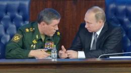 FILE PHOTO. Russian President Vladimir Putin (R) talks with the Chief of Russian general staff Valery Gerasimov (L). EPA, ALEXEY DRUZHININ / SPUTNIK / KREMLIN POOL MANDATORY CREDIT