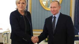French presidential candidate and far-right Front National political party's leader Marine Le Pen (L) shakes hands with Russian President Vladimir Putin (R) during a meeting in the Kremlin in Moscow, Russia, 24 March 2017. EPA, MICHAEL KLIMENTYEV, SPUTNIK, KREMLIN / POOL MANDATORY CREDIT