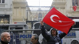 Supporters of Turkish President Recep Tayyip Erdogan shout slogans against the Netherlands in front of the Dutch Consulate in Istanbul, Turkey 12 March 2017. Turkish Family Minister Fatma Betul Sayan Kaya was barred by police from entering the Turkish consulate in Rotterdam on 11 March, after the Dutch government had denied landing rights to Turkish Foreign Minister Cavusoglu who planned a speech at the consul's residence in Rotterdam. The incidents have led to a diplomatic row between the two countries, and protests by Turkish citizens in the Netherlands as well as in Turkey. EPA/CEM TURKEL