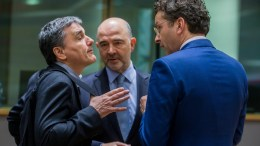 Greek Finance Minister Euclid Tsakalotos (L) and European Commissioner in charge of Economic and Financial Affairs, Pierre Moscovici (C) and President of Eurogroup, Dutch Finance Minister, Jeroen Dijsselbloem (R) prior to the start of a Eurogroup Finance Ministers' meeting at the European Council headquarters in Brussels, Belgium. EPA/STEPHANIE LECOCQ