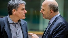 FILE PHOTO. Greek Finance Minister Euclid Tsakalotos (L) and European Commissioner in charge of Economic and Financial Affairs, Pierre Moscovici (R) speak prior to the start of a Eurogroup Finance Ministers' meeting. EPA/STEPHANIE LECOCQ