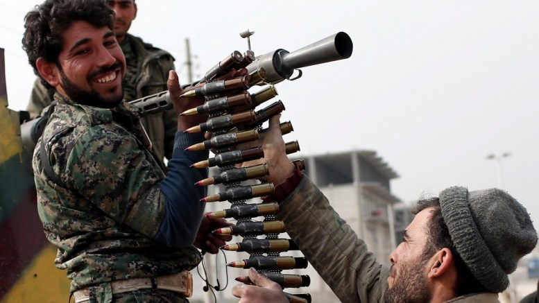 FILE PHOTO. Members of Syrian Kurdish People's Defence Units (YPG) prepare their machine gun in, Syria. EPA/SEDAT SUNA