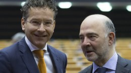 FILE PHOTO. Dutch Finance Minister and President of Eurogroup Jeroen Dijsselbloem (L) and European Commissioner in charge of Economic and Financial Affairs Pierre Moscovici (R) converse during presention of the State of Play of the second review of the economic adjustment programme for Greece at a mini-plenary session of the European Parliament in Brussels, Belgium, 27 April 2016. EPA/OLIVIER HOSLET
