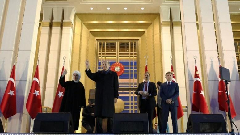 Turkish President Recep Tayyip Erdogan (2-L) speaks during a rally after referendum victory, at the Presidential Palace in Ankara, Turkey. EPA, TUMAY BERKIN