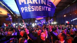 Supporters of French presidential election candidate for the far-right Front National (FN) party, Marine Le Pen (unseen) celebrate after the results of the first round of the presidential elections at her headquarters in Henin-Beaumont, Northern France, 23 April 2017. Media reports that polling agencies projections put Le-Pen and centrist presidential candidate Emmanuel Macron ahead in the vote. France will hold the second round of the presidential elections on 07 May 2017. EPA, IAN LANGSDON