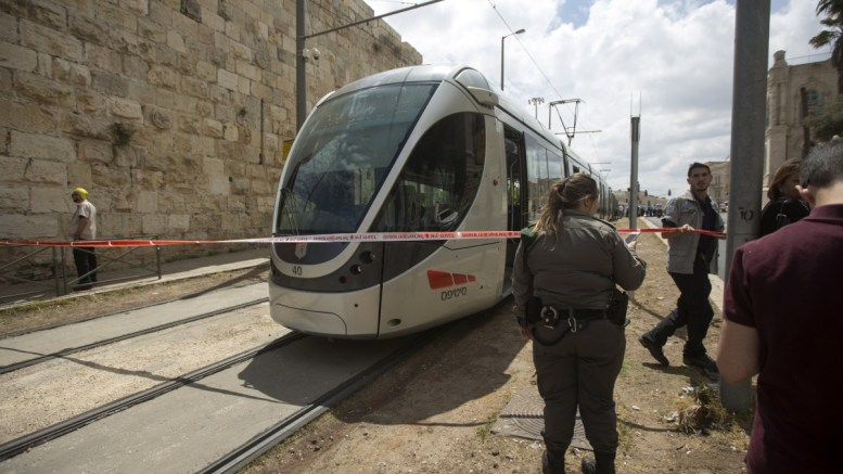 FILE PHOTO. Israeli Police and medical personnel inspect the scene of an attack. EPA/ATEF SAFADI