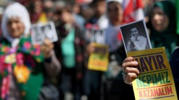 File Photo: Supporters of the pro-Kurdish party Peoples' Democratic Party (HDP) hold pictures of HDP Leader Selahattin Demirtas who were arrested. EPA, SEDAT SUNA