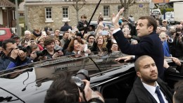 French presidential election candidate for the 'En Marche!' (Onwards!) political movement, Emmanuel Macron, waves to a crowd as he leaves a polling station after casting his ballot in the first round of 2017 French presidential elections in Le Touquet, France, 23 April 2017. France will hold the second round of the presidential elections on 07 May 2017. EPA, YOAN VALAT
