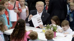 US President Donald J. Trump makes cards for members of the military at the annual Easter Egg roll on the South Lawn of the White House in Washington, DC, USA. EPA, OLIVIER DOULIERY, SIPA POOL