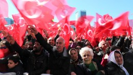 Supporters of the Republican People's Party (CHP) hold Turkish flags and shout slogans for 'Vote No' referring to upcoming referendum during a rally for opening ceremony of Sariyer District Municipality building, in Istanbul, Turkey. EPA, TOLGA BOZOGLU