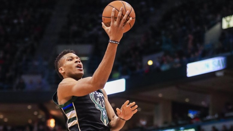 Milwaukee Bucks forward Giannis Antetokounmpo of Greece (L) goes to the basket on New York Knicks forward Carmelo Anthony (R) in the second half of their NBA game at the BMO Harris Bradley Center in Milwaukee, Wisconsin, USA, 06 January 2017. The Knicks defeated the Bucks  EPA/TANNEN MAURY