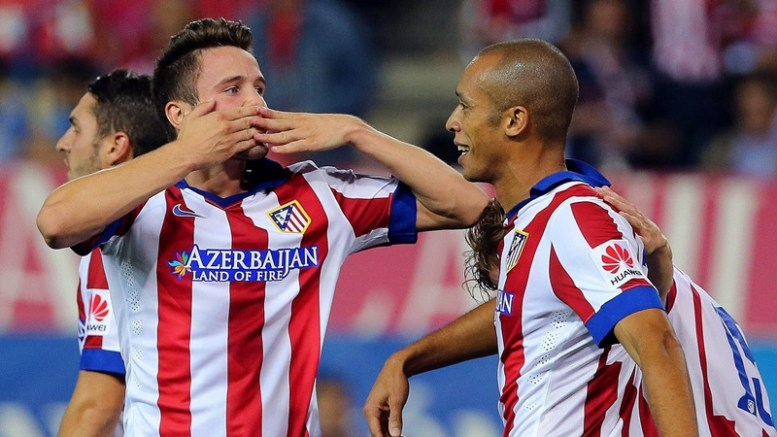 Atletico Madrid's midfielder Saul Niguez (L) celebrates with his teammate Joao Miranda (R) after scoring the 2-0 lead during the Spanish Primera Division soccer match between Atletico Madrid and Sevilla FC at Vicente Calderon stadium in Madrid, Spain, 27 September 2014.  EPA/BALLESTEROS