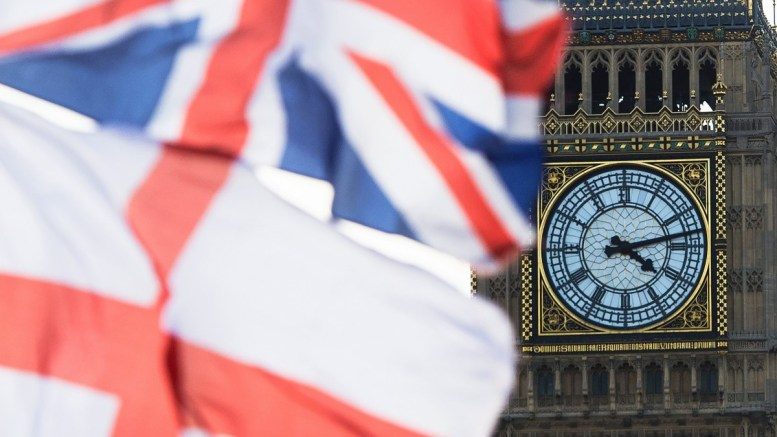 A British Union Jack flag and a flag of England fly in front of Big Ben in the Houses of Parliament in London, Britain. EPA/FACUNDO ARRIZABALAGA