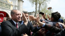 A handout photo made available by Turkish President Press office shows Turkish President Recep Tayyip Erdogan (L) greeting people. EPA/TURKISH PRESIDENT PRESS OFFICE HANDOUT HANDOUT EDITORIAL USE ONLY/NO SALES