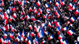Supporters cheering as 'Les Republicains' party candidate for the 2017 French presidential elections, Francois Fillon delivers a speech during a meeting organized to support him on the Place du Trocadero in Paris, France. EPA, ETIENNE LAURENT