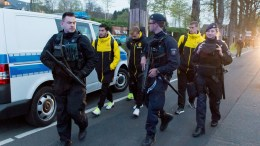 Borussia Dortmund players (L-R) Nuri Sahin, Marcel Schmelzer and Sven Bender are escorted by police after their team bus was hit by three explosions ahead of their UEFA Champions League soccer match against AS Monaco in Dortmund, Germany, 11 April 2017. EPA, STR