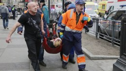 FILE PHOTO. Russian rescuers carry a victim of an explosion at Tekhnologichesky Institute metro station in Saint Petersburg, Russia, 03 April, 2017. According to reports, at least 10 people were killed and dozens injured in an explosion in the city's metro system. EPA, ANTON VAGANOV