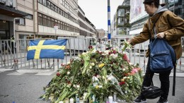 People gather at a police cordon near the crime scene in central Stockholm, Sweden, 08 April 2017. EPA/NOELLA JOHANSSON SWEDEN OUT
