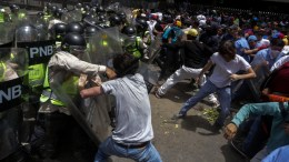 FILE PHOTO. Protesters clash with members of National Bolivarian Police (PNB) during a march organized by opposition members in Caracas, Venezuela. EPA/CRISTIAN HERNANDEZ