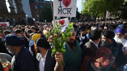 People attend a vigil for the victims who lost their lives during the Manchester terror attack in central Manchester, Britain, 23 May 2017. Britain is on high alert following the Manchester terror attack on the Manchester Arena late 22 May, that saw 22 people lose their lives with scores of other people injured. EPA, ANDY RAIN