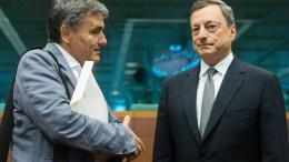 FILE PHOTO. Greek Finance Minister Euclid Tsakalotos (L) and President of the European Central Bank (ECB) Mario Draghi (R) prior to the start of a Eurogroup Finance Ministers' meeting at the EU Council, in Brussels, Belgium. EPA, STEPHANIE LECOCQ