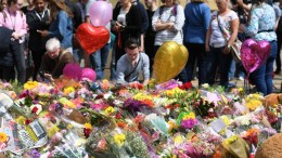 File Photo: People look over floral tributes in St. Ann's Square for the people who lost their lives during the Manchester terror attack in central Manchester, Britain, 24 May 2017. EPA, ANDY RAIN
