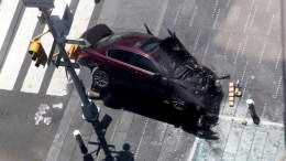 A vehicle sits atop a bollard after multiple people were injured when a vehicle struck numerous pedestrians in Times Square in New York City, New York, USA, 18 May 2017. Reports indicated that the vehicle was possibly speeding when it drove up onto the sidewalk striking the pedestrians. EPA/GARY HE