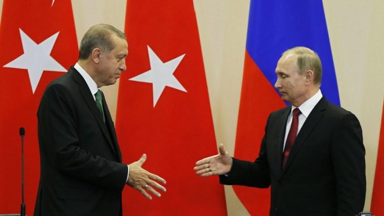 FILE PHOTO. Russian President Vladimir Putin (R) and Turkish President Recep Tayyip Erdogan shakes hands after a press conference at the Bocharov Ruchei residence in the Black sea resort of Sochi. EPA, YURI KOCHETKOV